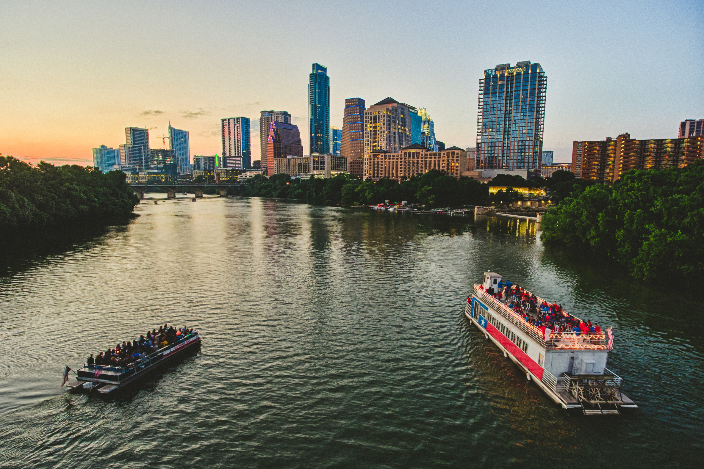 Austin skyline with boat tours credit geoff duncan exp May 2020